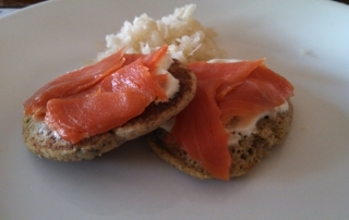 Buckwheat Pancakes with Smoked Salmon, Lemon Sour Cream and Sauerkraut