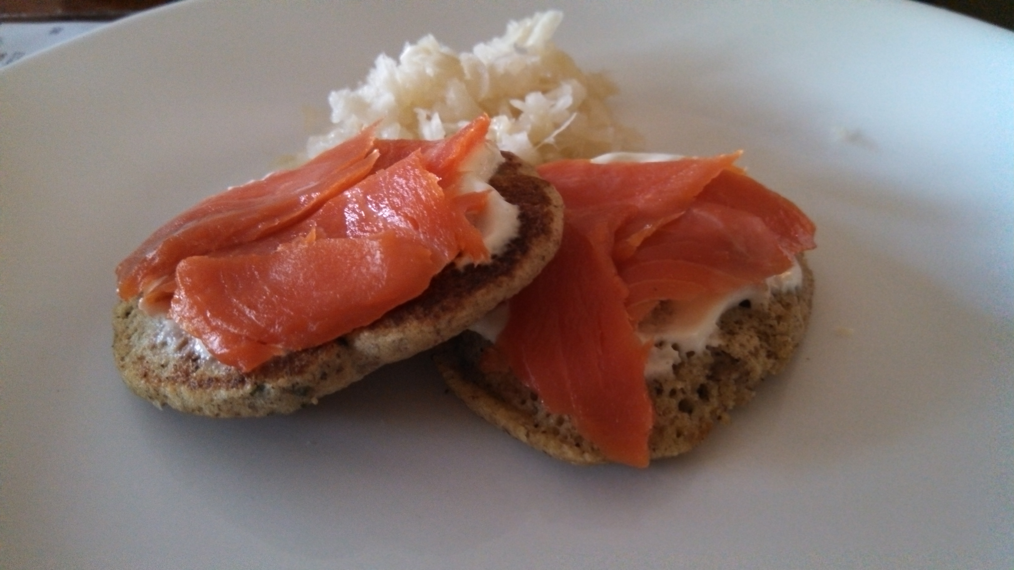 Buckwheat Blinis with Smoked Salmon, Lemon Sour Cream and Sauerkraut
