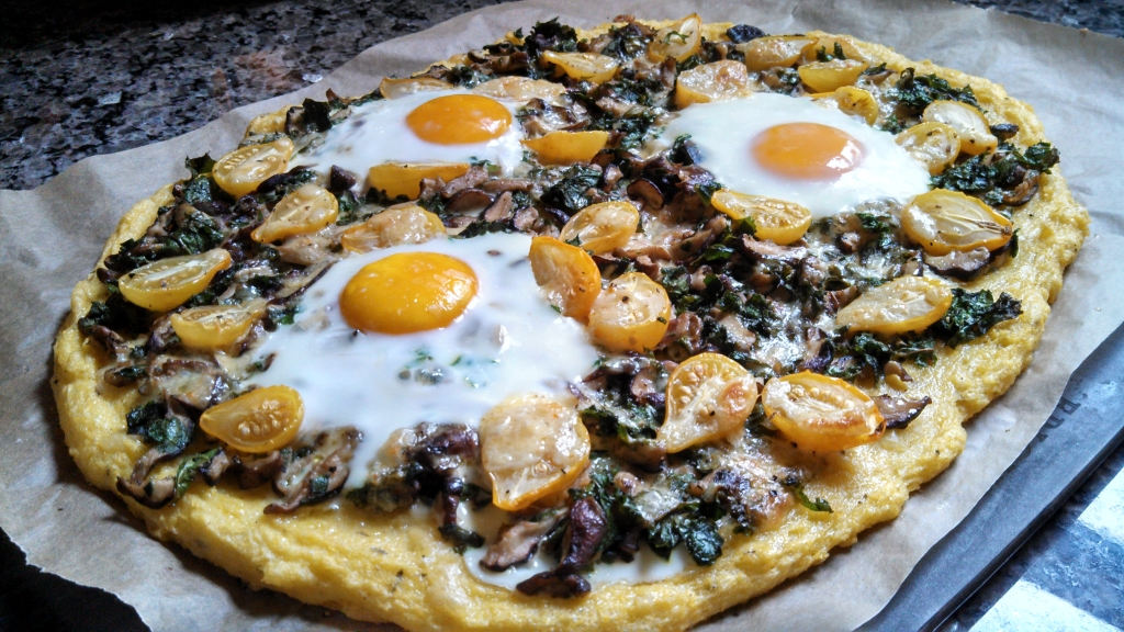 Polenta Pizza with Mushrooms, Kale, Cherry Tomatoes and Baked Eggs