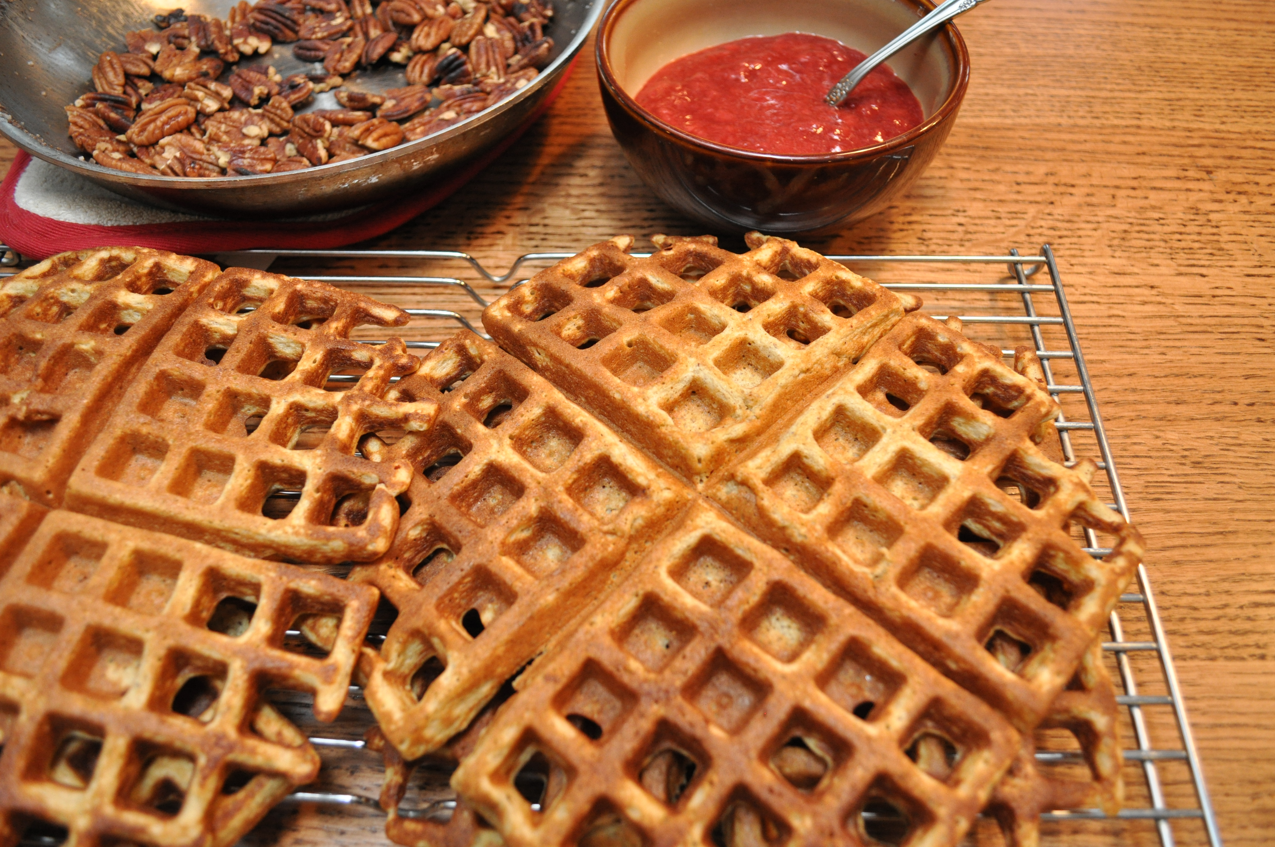 Whole grain waffles (gluten fre) with fresh strawberry sauce and toasted pecans