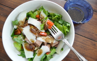 Arugula and Steak Salad with Grilled Onions and Peppers and Shaved Parmesan