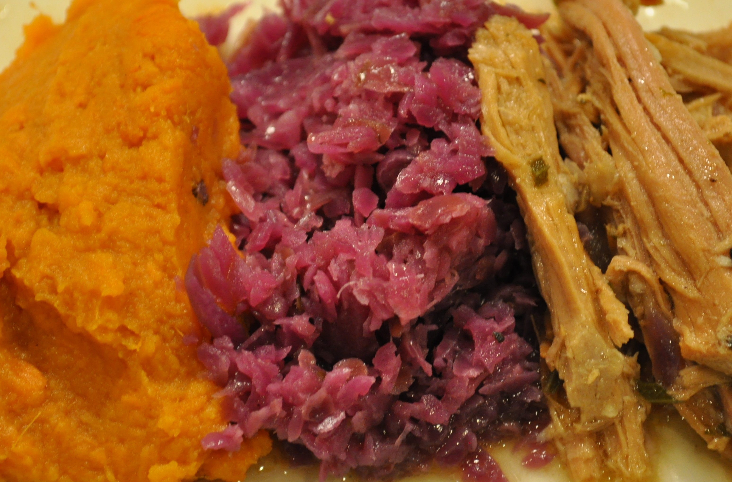 Braised red cabbage with mashed sweet potatoes and pulled pork
